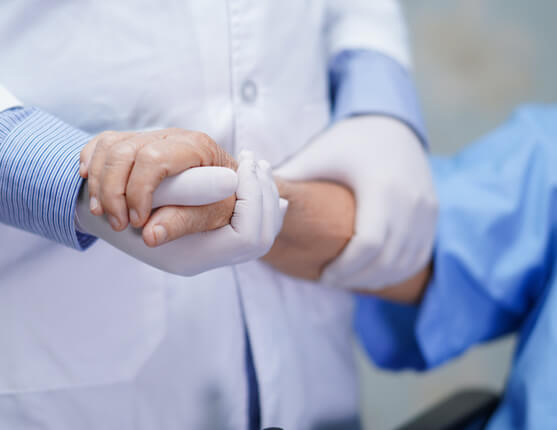 Close up of dr holding patients arm